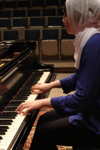 Habash playing piano.