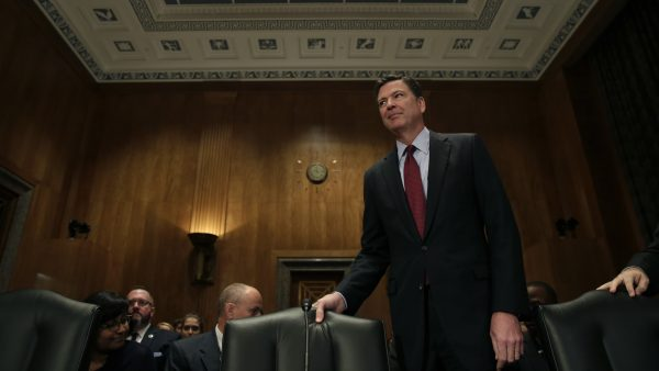 FBI Director James Comey arrives at a Senate Committee on Homeland Security hearing earlier this year.