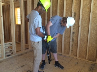 Students use screws to fasten sub-floor to the frame of SURVIV(AL) house. Usually nails are used for this purpose.