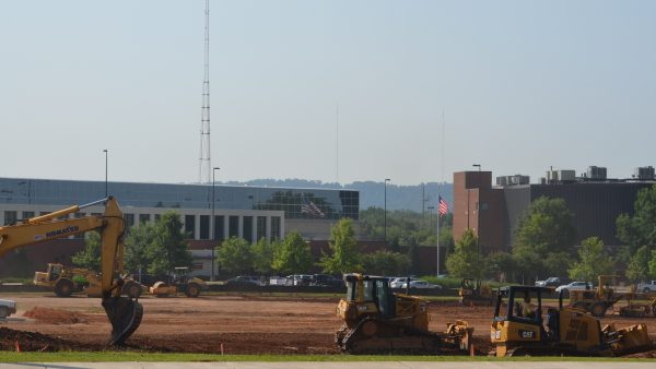 Workers prepare the site for a new hotel and restaurants at the CrossPlex on Third Avenue West.