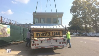 The last section of roof is loaded onto the truck and secured for transport to Denver.