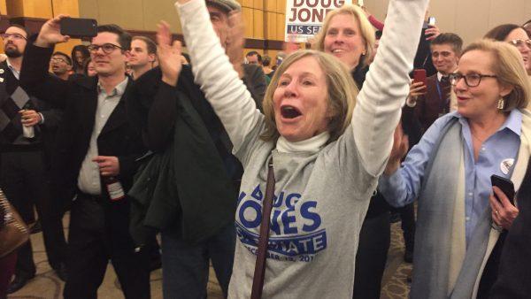 Supporters of Democrat Doug Jones celebrate his victory over GOP opponent Roy Moore.