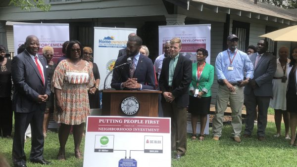 Mayor Randall Woodfin introduces the 100 Homes in 100 Days program in July to help revitalize neighborhoods.