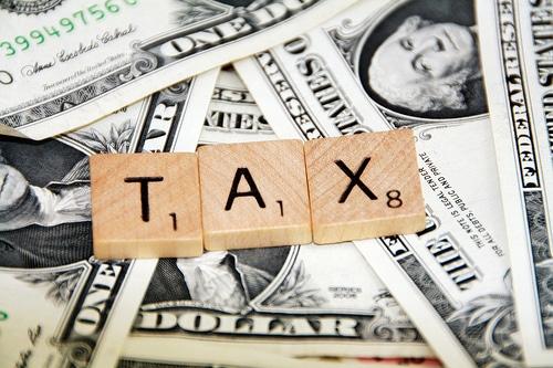 https://wbhm.org/wp-content/uploads/2015/04/6355404323_cf97f9c58e_taxes.jpg