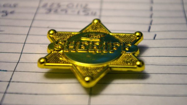 https://wbhm.org/wp-content/uploads/2020/05/Sheriff_Badge-600x338.jpg