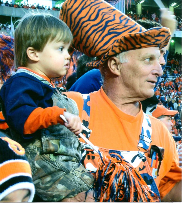 Fred Bishoff with his grandson at an Auburn University football game