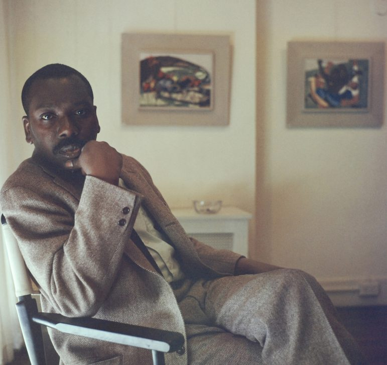 Artist Jacob Lawrence with panels 26 and 27 from Struggle: From the History of the American People