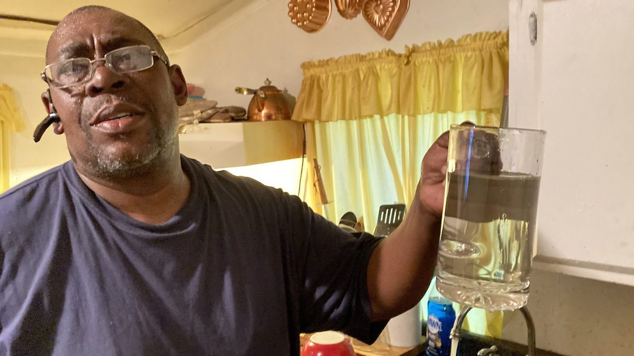 George Reynolds filled a glass of water at his house in Murphy, Miss.