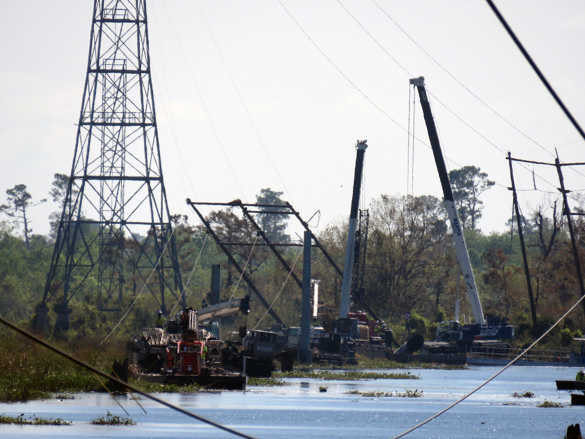 Entergy crews work to restore a transmission tower in North Lake Charles that was damaged by Hurricane Laura in August 2020.