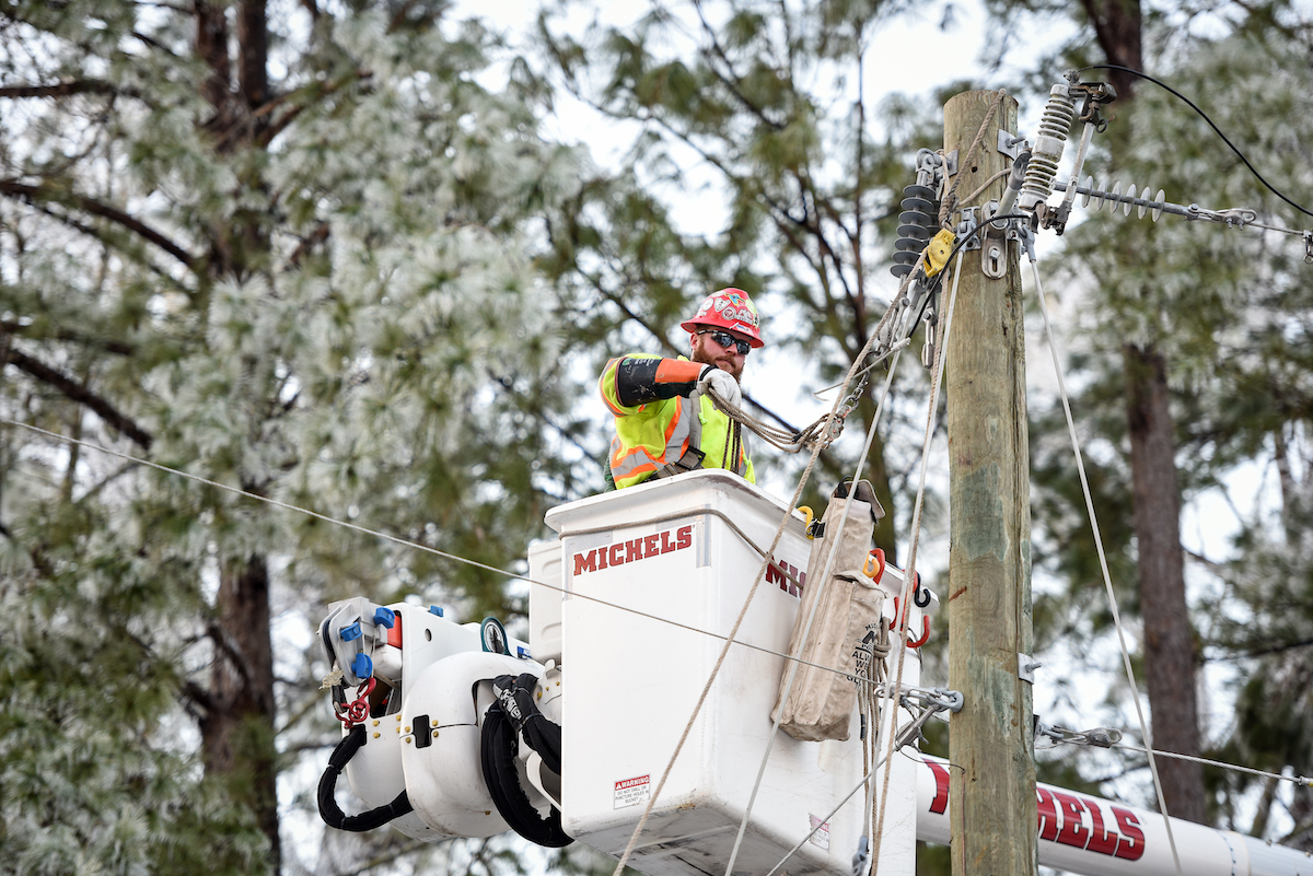 An Entergy crewmember works to restore power to a neighborhood in Vicksburg, Mississippi after Winter Storm Uri swept through the region, Feb. 19, 2021.