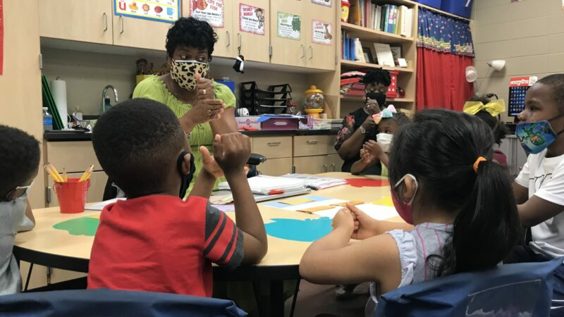 Kimberly Isaac, who is a teacher at West End Academy, guides students in phonics practice at a summer literacy camp.