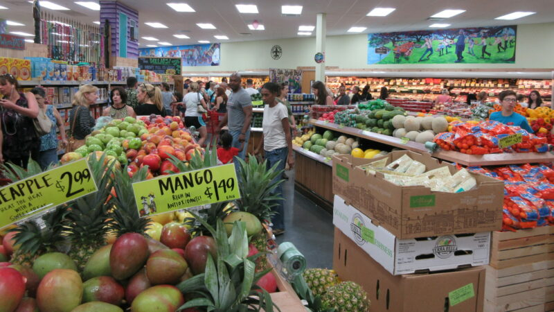 In this file photo, a group of people shop in the produce section of a Trader Joe's grocery store in Metairie, Louisiana.
