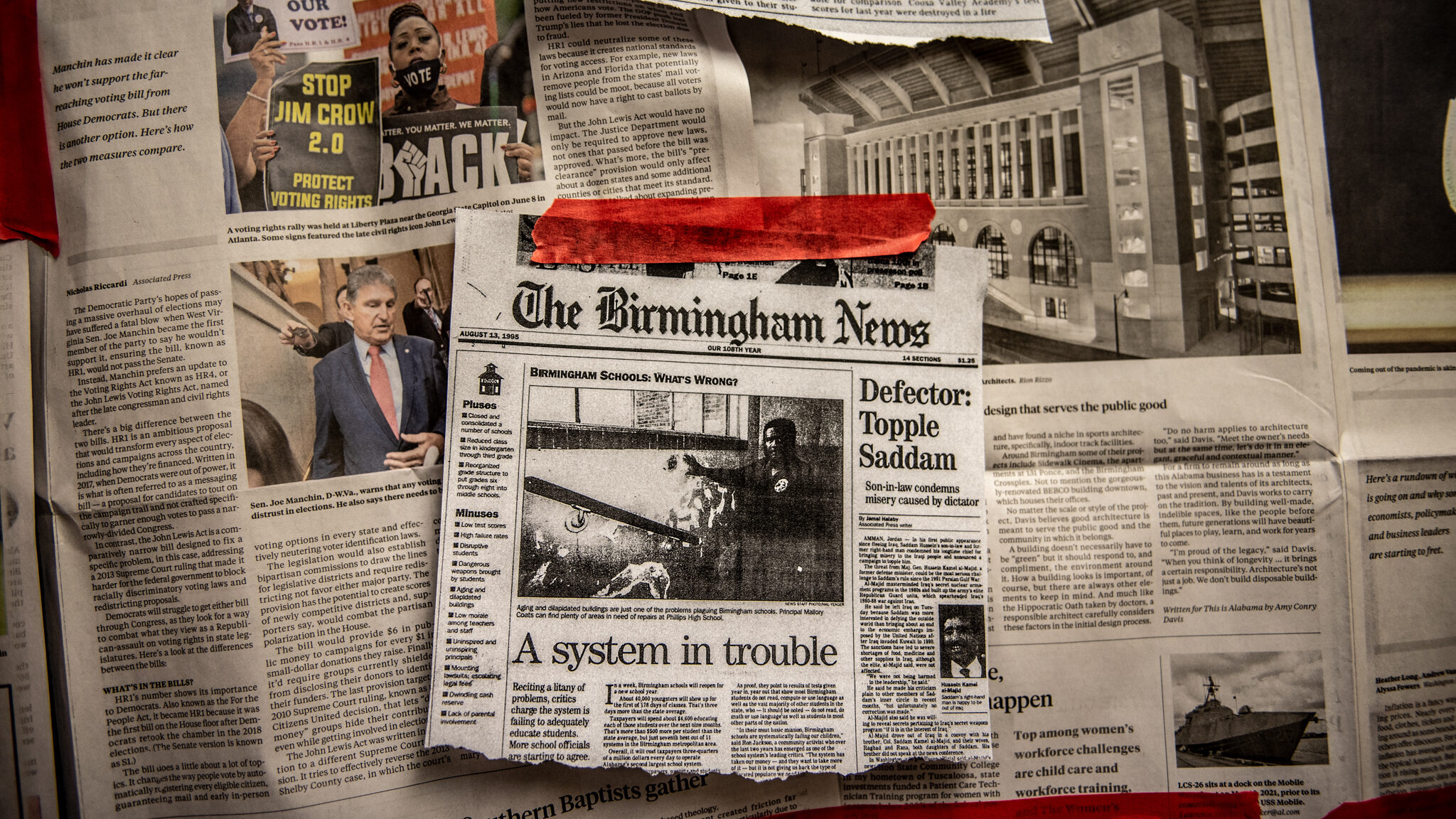 """Articles about Birmingham public schools were displayed during the """"All-In"""" interactive art exhibit at Ramsey High School."""
