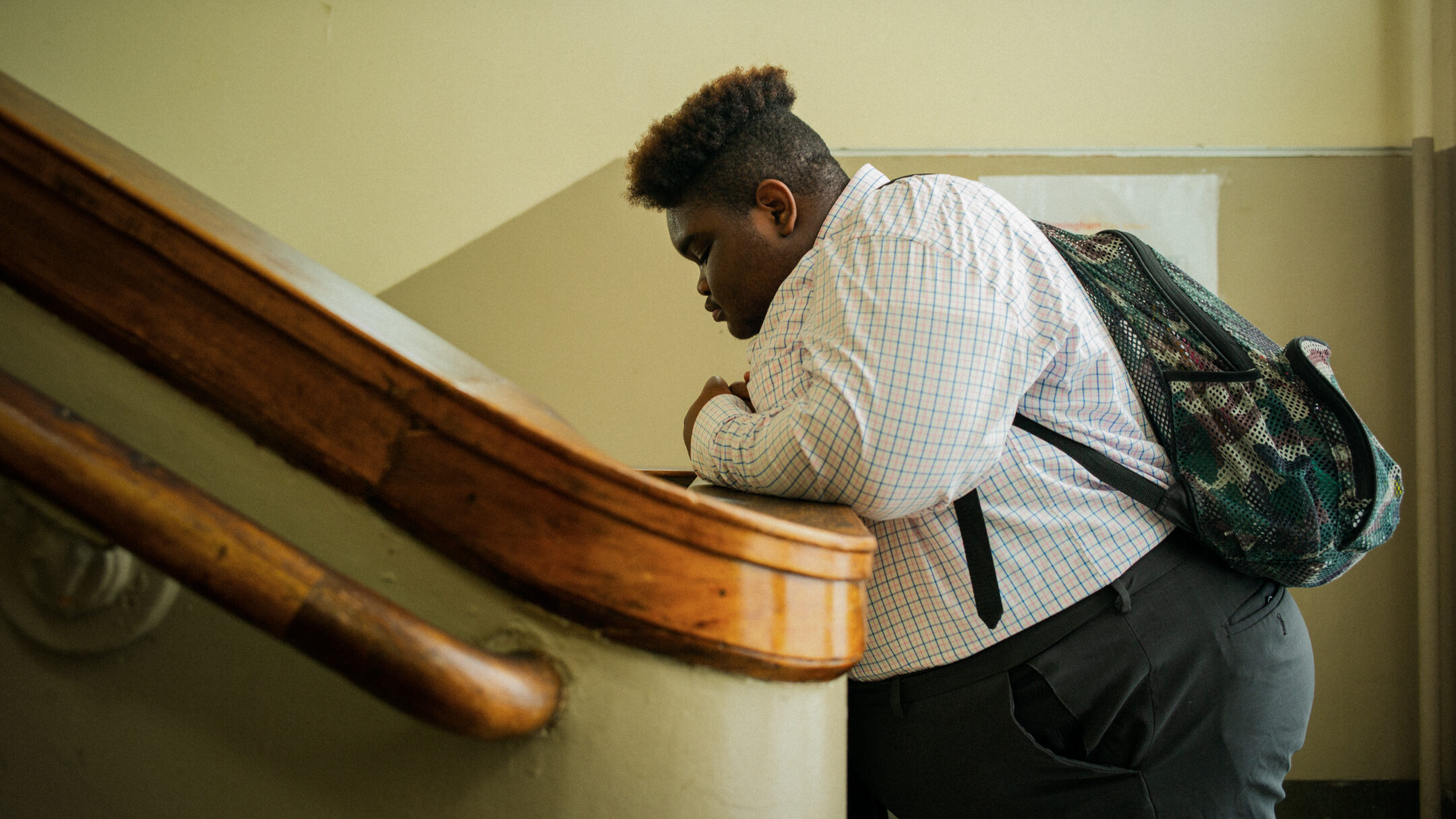 """Keion Gilmore, a senior at Ramsey High School featured in the """"All-In"""" documentary and exhibit, reflects on the stairwell."""